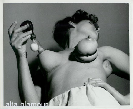 Breasts fondled in bondage